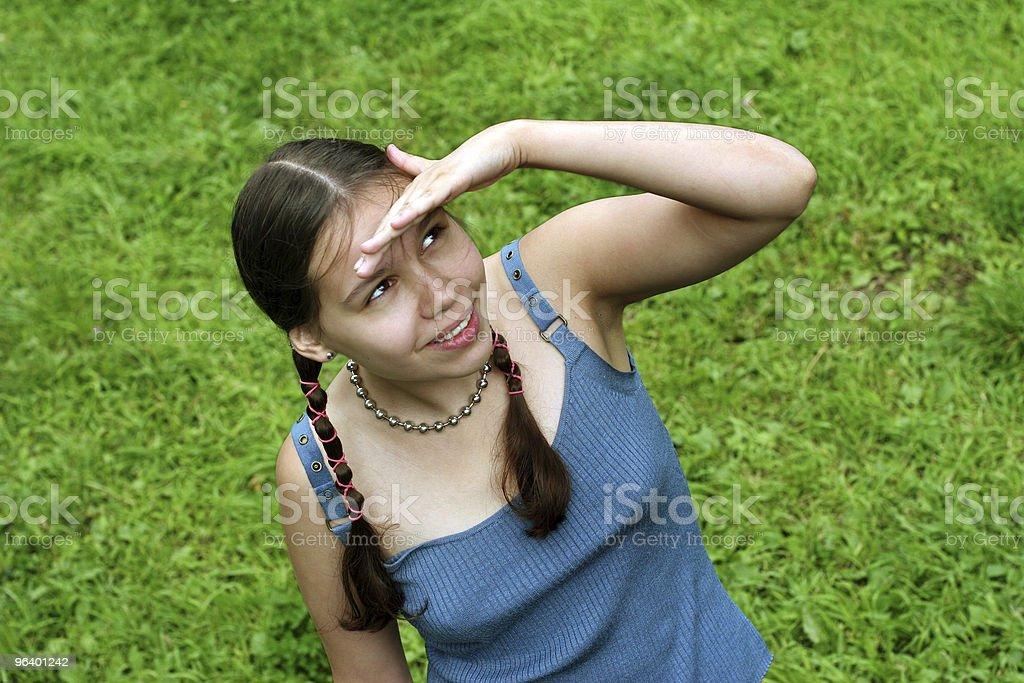 Teenage girl looking up royalty-free stock photo