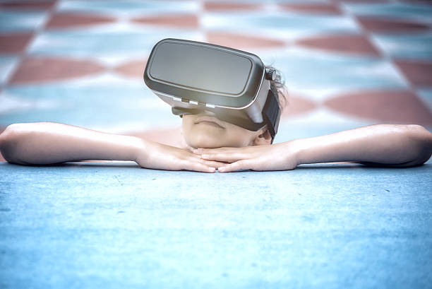 teenage girl looking with black virtual reality simulator - softwarekunst stock-fotos und bilder