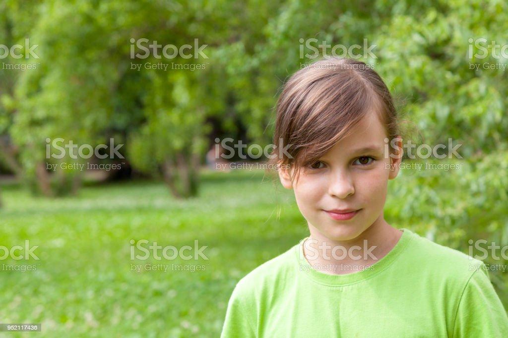 A teenage girl looks at the camera stock photo