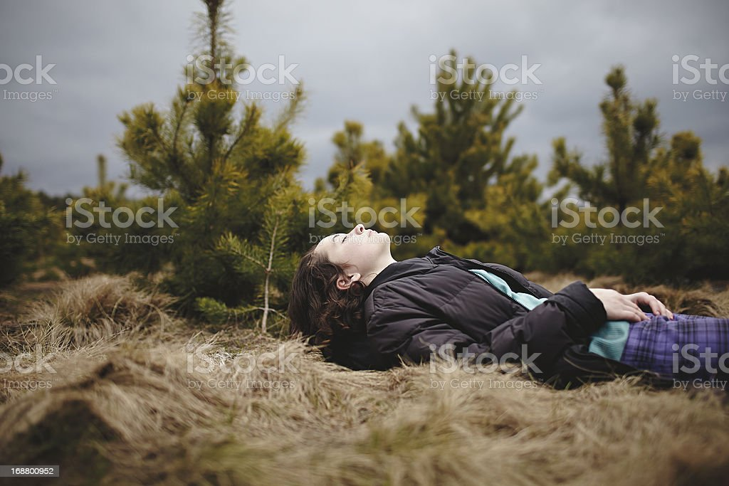 Teenage Girl lying in the Woods royalty-free stock photo