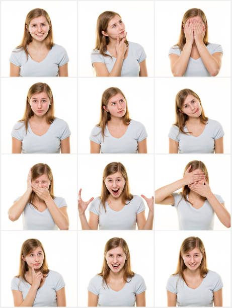 Teenage girl making facial expressions stock photo