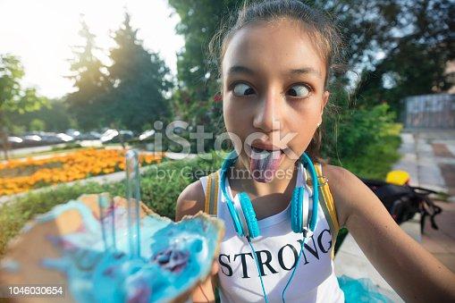 Teenage girl making selfie with ice cream.