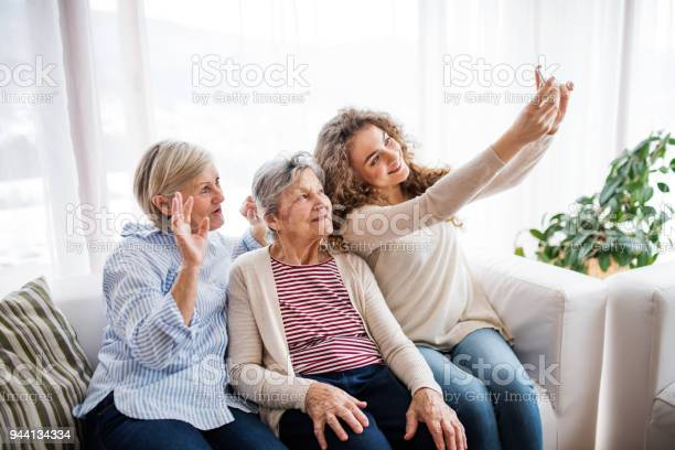 Teenage girl mother and grandmother with smartphone at home picture id944134334?b=1&k=6&m=944134334&s=612x612&h=htlm hmsiznytyalgetlfbsgjapc3aoiobzlg6q0vqs=