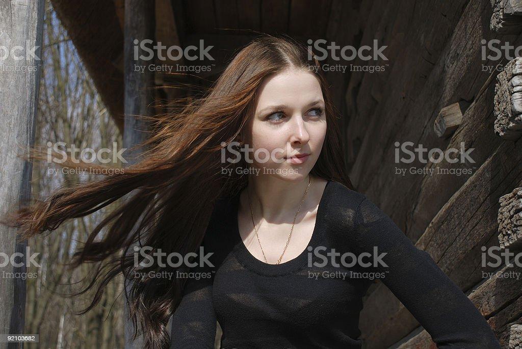Teenage girl near old timber wall royalty-free stock photo
