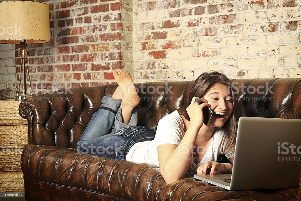 Teenage Girl Networking on Sofa royalty-free stock photo
