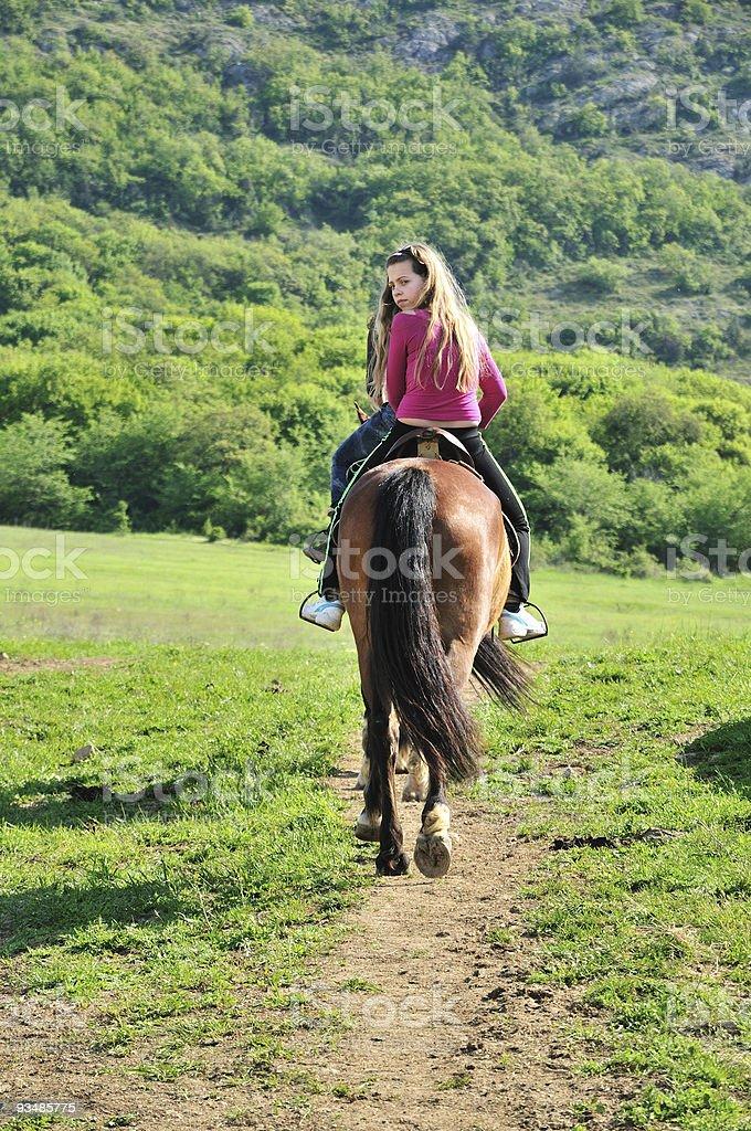 teenage girl on a horse stock photo