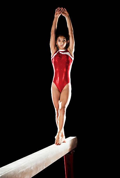 teenage girl on balance beam. - balance beam stock photos and pictures