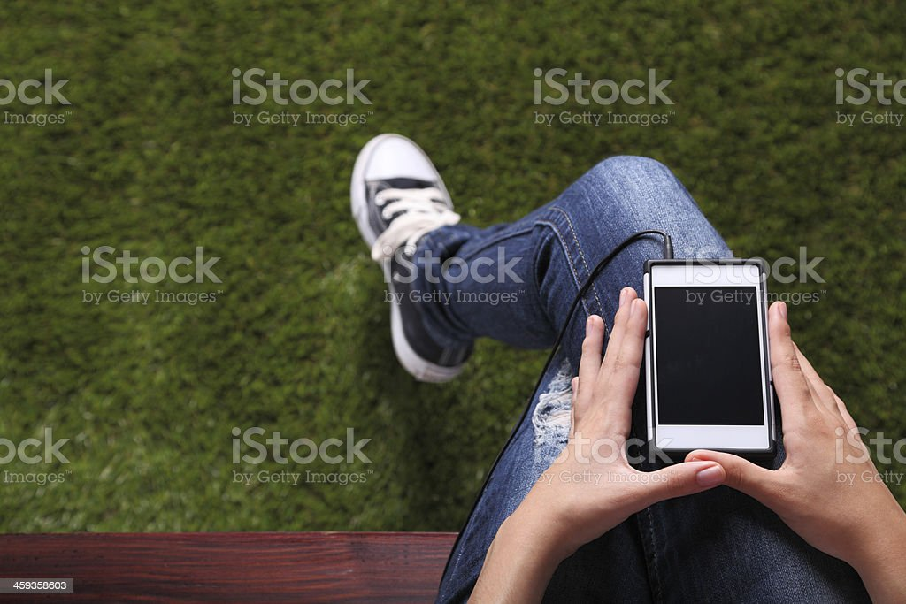 A teenage girl on her smartphone royalty-free stock photo