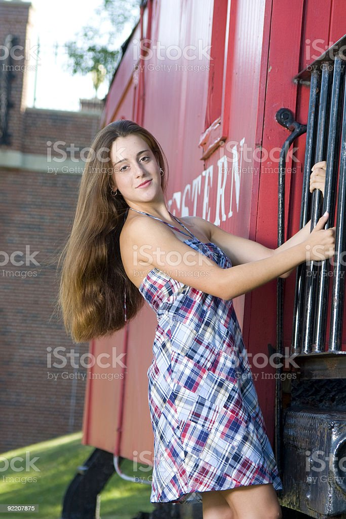 Teenage Girl on Red Caboose royalty-free stock photo