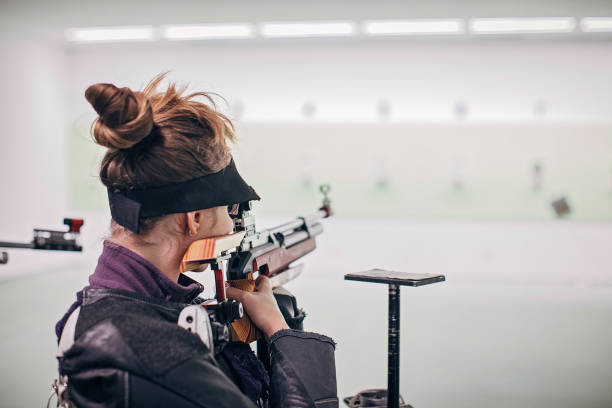Teenage girl on rifle shooting practice stock photo