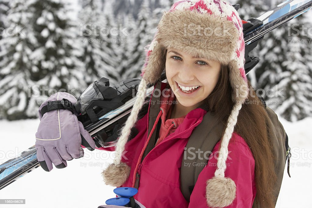 Teenage Girl On Ski Holiday In Mountains royalty-free stock photo