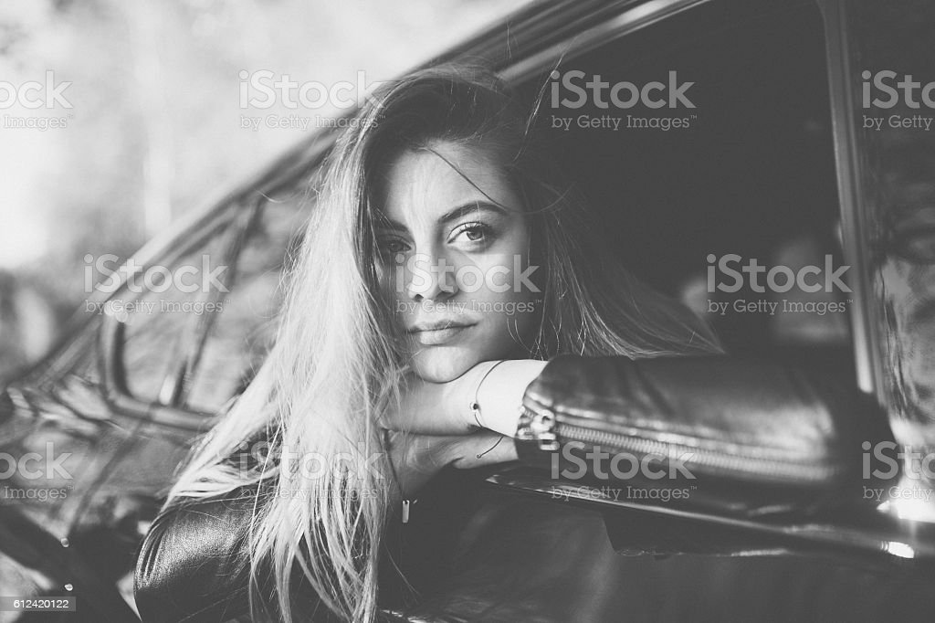 Teenage girl on the window car stock photo