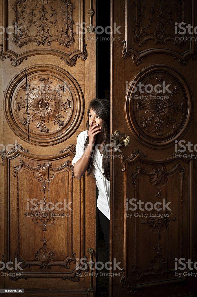 Teenage girl peeping royalty-free stock photo