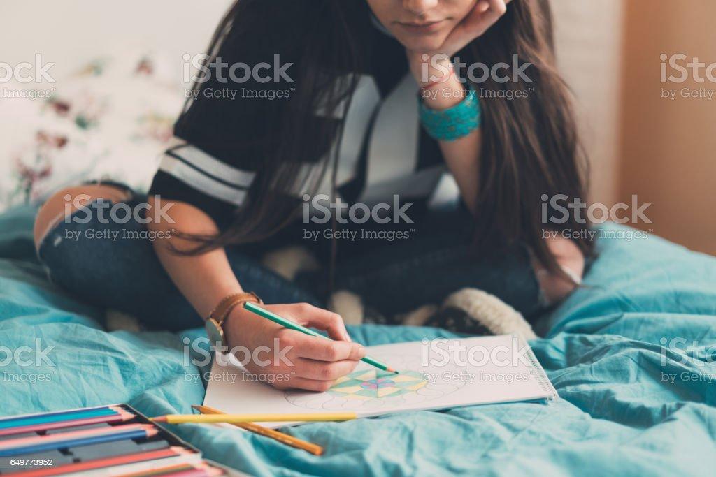 Teenage girl pencil drawing at home stock photo