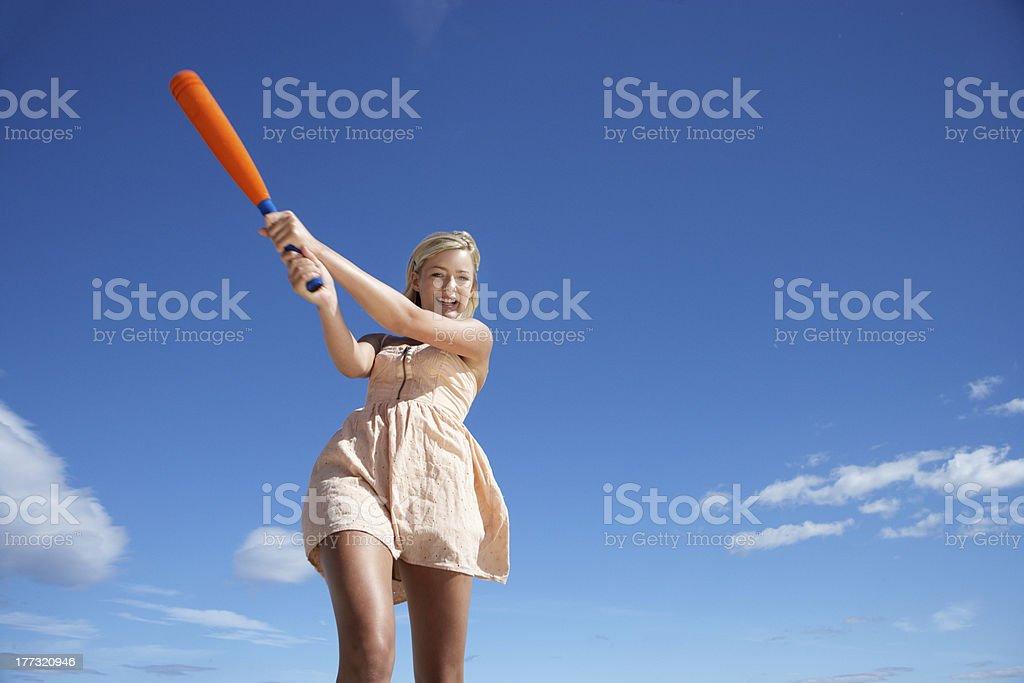 Teenage girl playing baseball stock photo