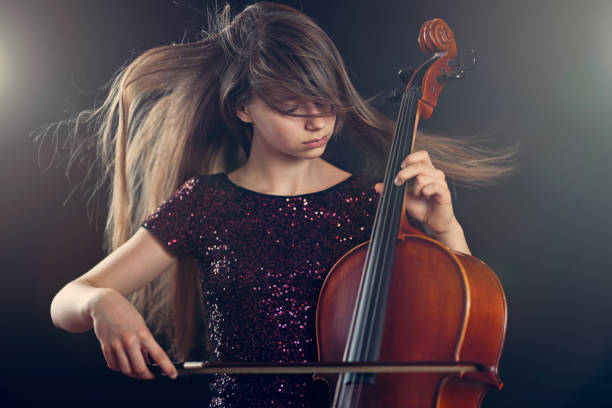 teenage girl playing cello performance - classical stock photos and pictures