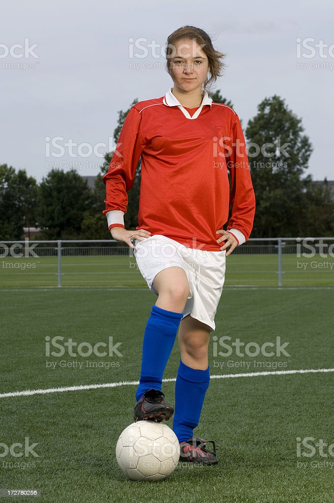 teenage girl playing soccer royalty-free stock photo