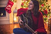 Teenage Girl Playing the Guitar
