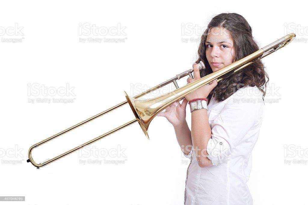 Teenage girl playing the trombone stock photo