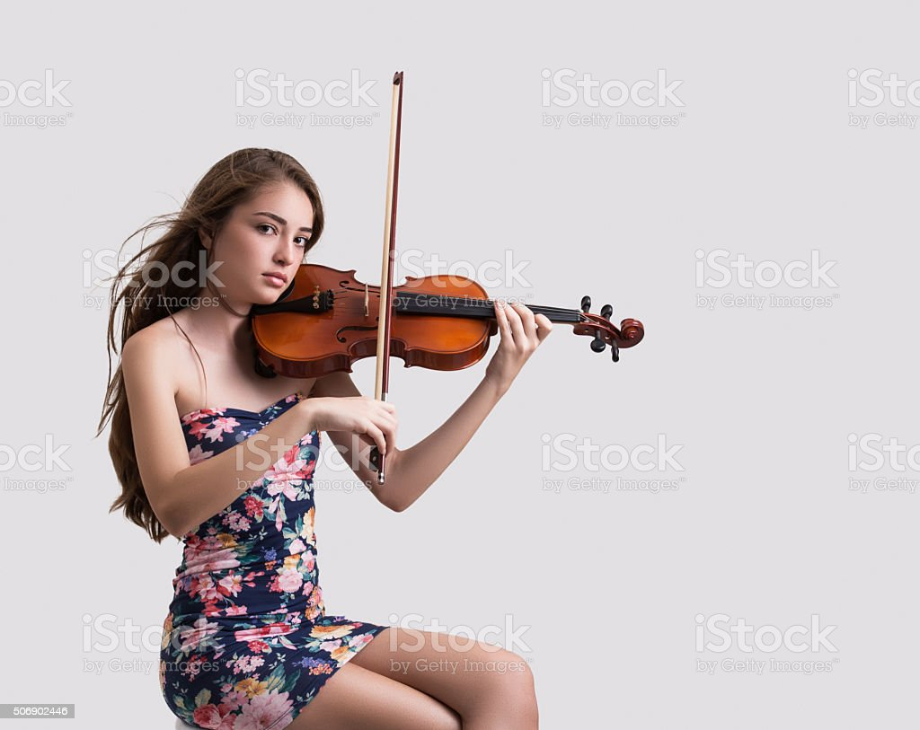 Teenage girl playing the violin stock photo