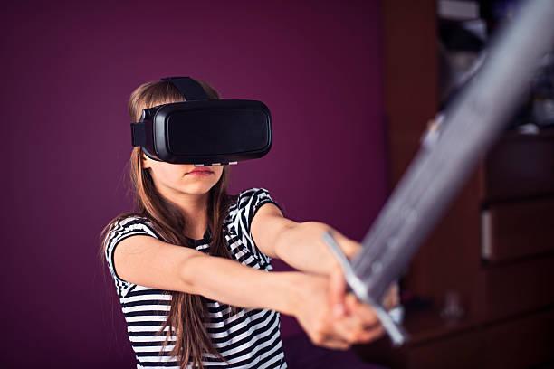 teenage girl playing with vr headset - lila mädchen zimmer stock-fotos und bilder