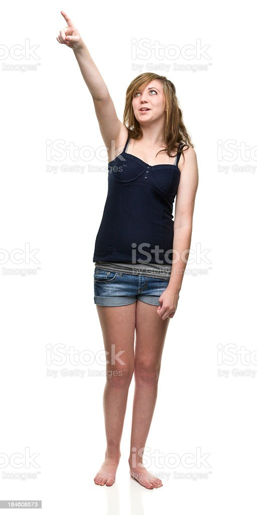 Teenage Girl Points Up royalty-free stock photo