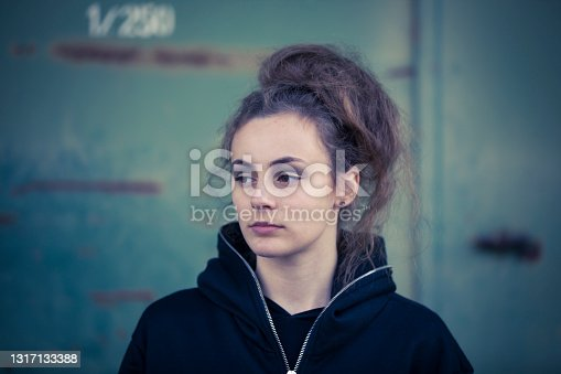 teenage girl portrait in urban surrounding.