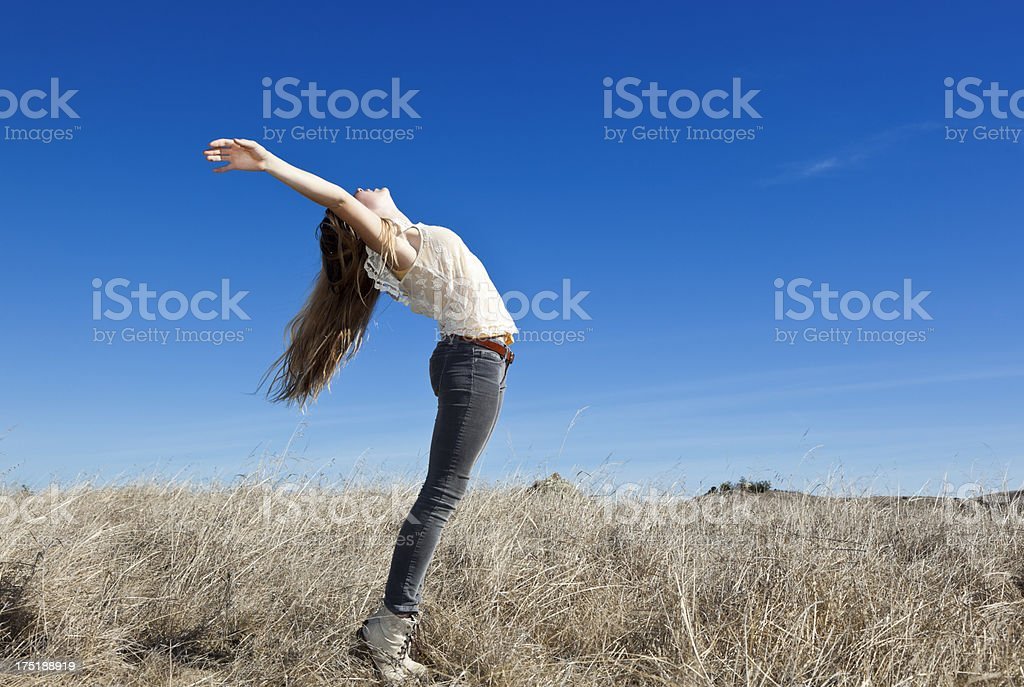 teenage girl practicing gymnastics in the sunlight royalty-free stock photo