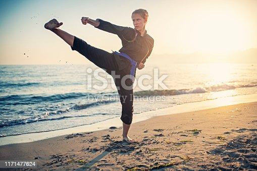 Teenage girl practicing kung fu on beach Nikon D850