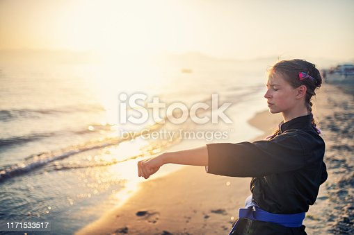 Teenage girl practicing kung fu on beach Nikon D850