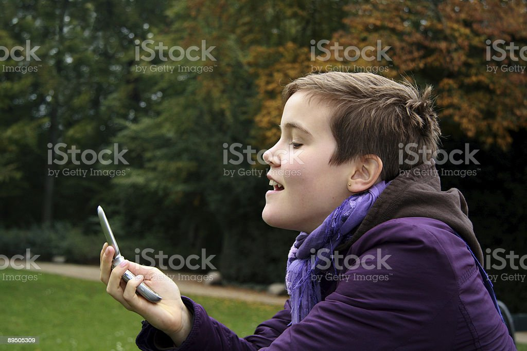 Teenage girl readind SMS from a friend royalty-free stock photo