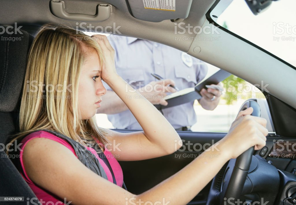 Teenage Girl Receiving a Ticket stock photo