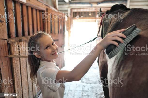 Teenage girl rider washes and brushes a horse in stable picture id1169414233?b=1&k=6&m=1169414233&s=612x612&h=nsu 0tjh3 50ec av i3vfdrjxra1mmdikzoylbumfq=