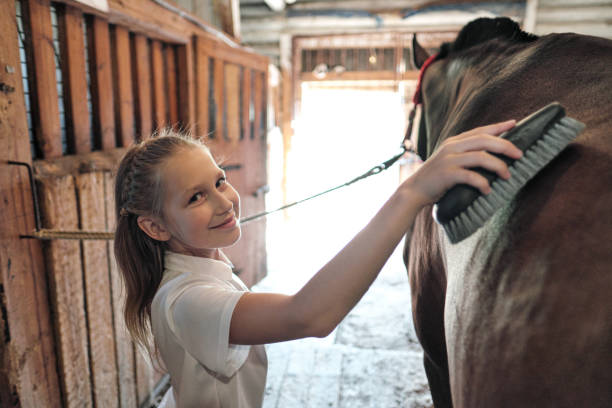 Teenage girl rider washes and brushes a horse in stable picture id1169414233?b=1&k=6&m=1169414233&s=612x612&w=0&h=ytghijd 8ui3mqua gj3hozkziwlhzvlxwqerq5vvug=
