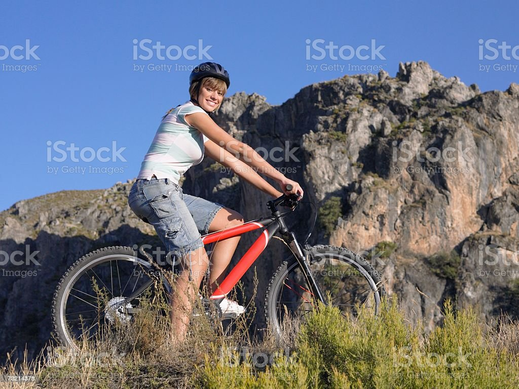 Teenage girl riding a bicycle royalty-free stock photo