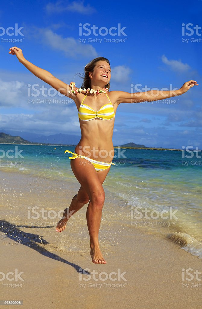 teenage girl runs along the beach royalty-free stock photo
