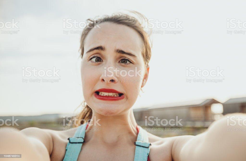 Teenage girl self portrait expression stock photo