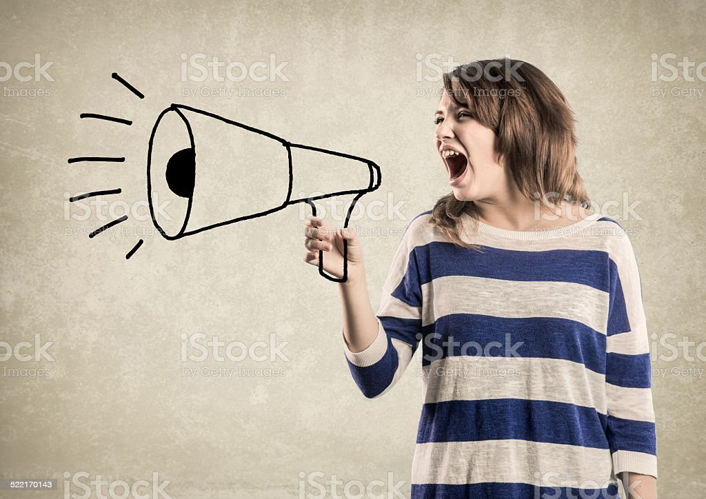 Teenage Girl, shouting in a Megaphone stock photo