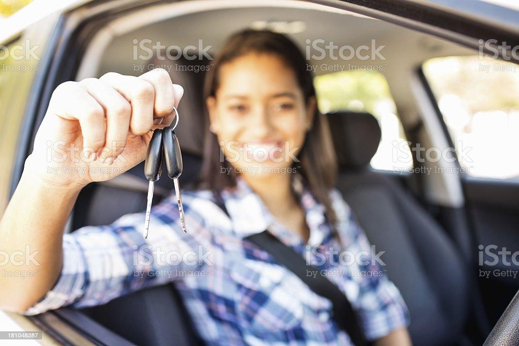 Teenage Girl Showing Keys While Sitting In Car stock photo