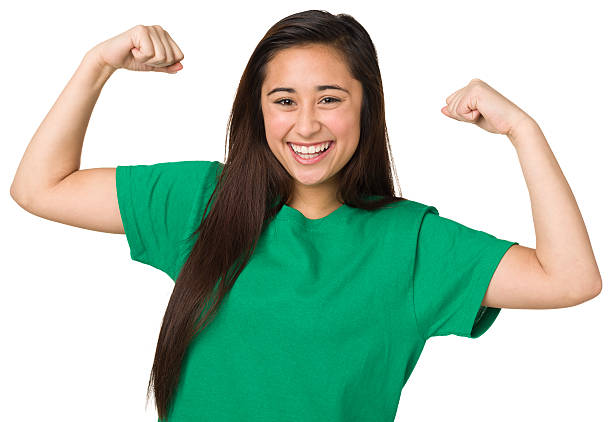 Teenage Girl Showing Off Muscles stock photo