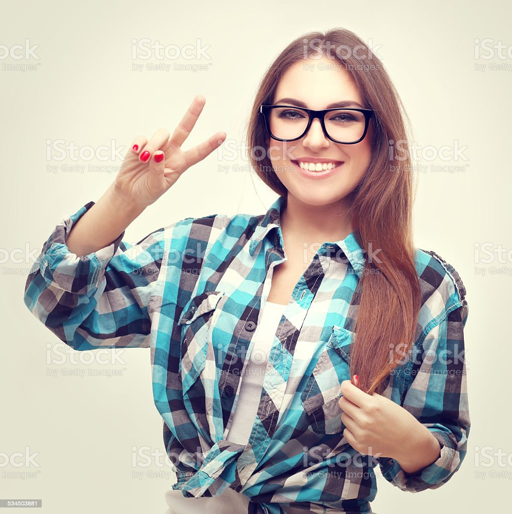 Teenage girl    showing victory sign stock photo