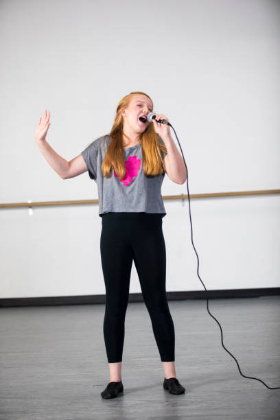 teenage girl singing at musical theatre class - audition stock photos and pictures
