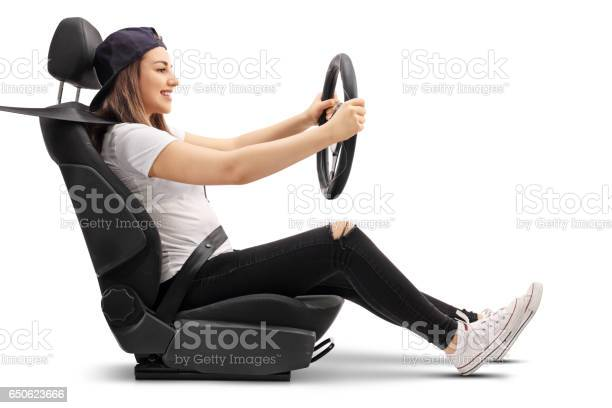 Teenage girl sitting in car seat and holding steering wheel picture id650623666?b=1&k=6&m=650623666&s=612x612&h=ogorfya2y9egsi1whyknhbq7bdoqqtekkdtbaoorbhc=