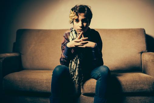 117149457 istock photo Teenage Girl sitting on sofà 181888547