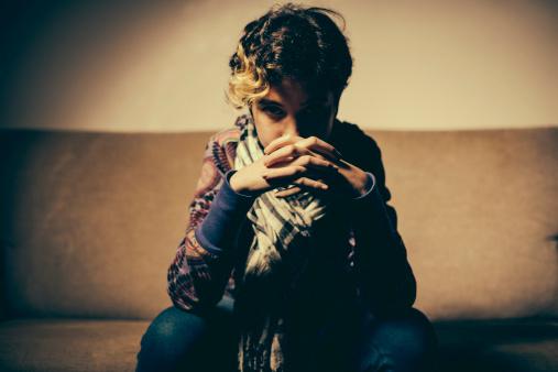 117149457 istock photo Teenage Girl sitting on sofà 181891826