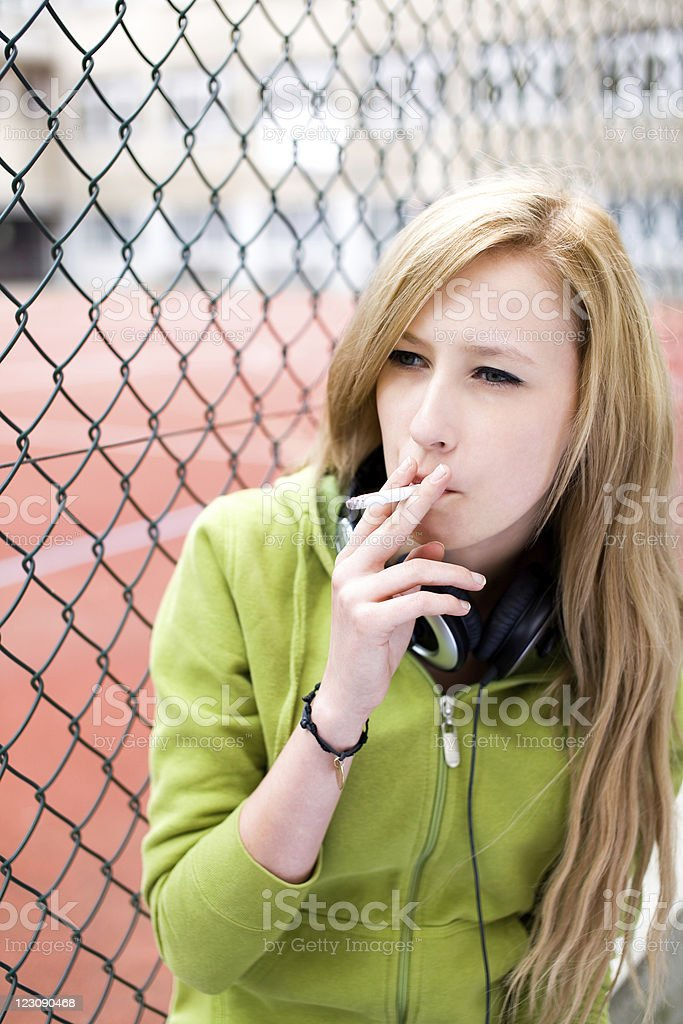 Teenage girl smoking royalty-free stock photo