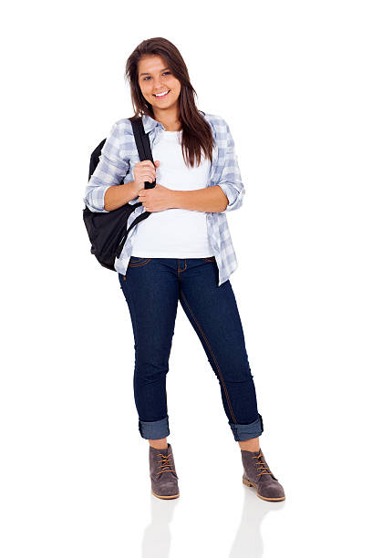 teenage girl standing on white background beautiful teenage girl with backpack standing on white background female high school student stock pictures, royalty-free photos & images