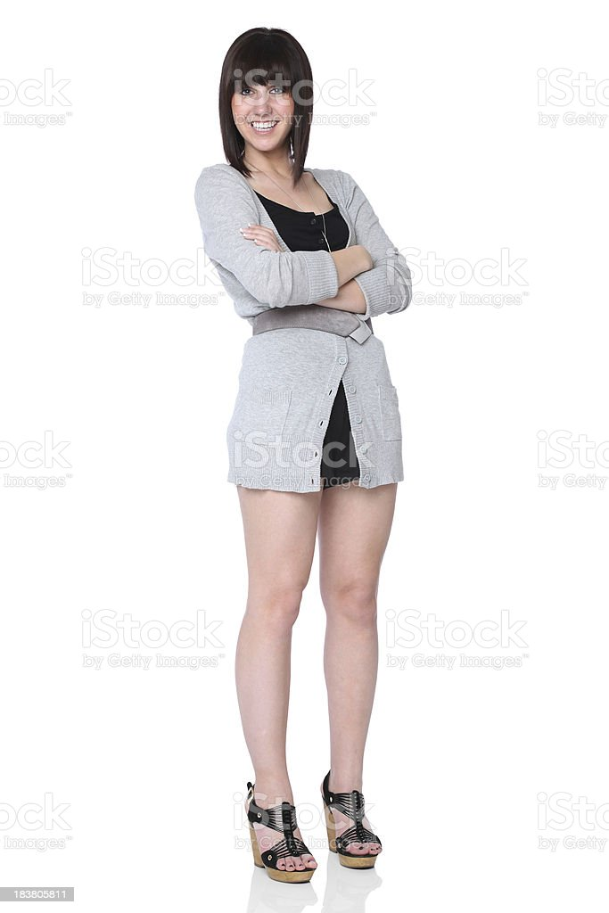 Teenage Girl Standing With Arms Crossed Stock Photo