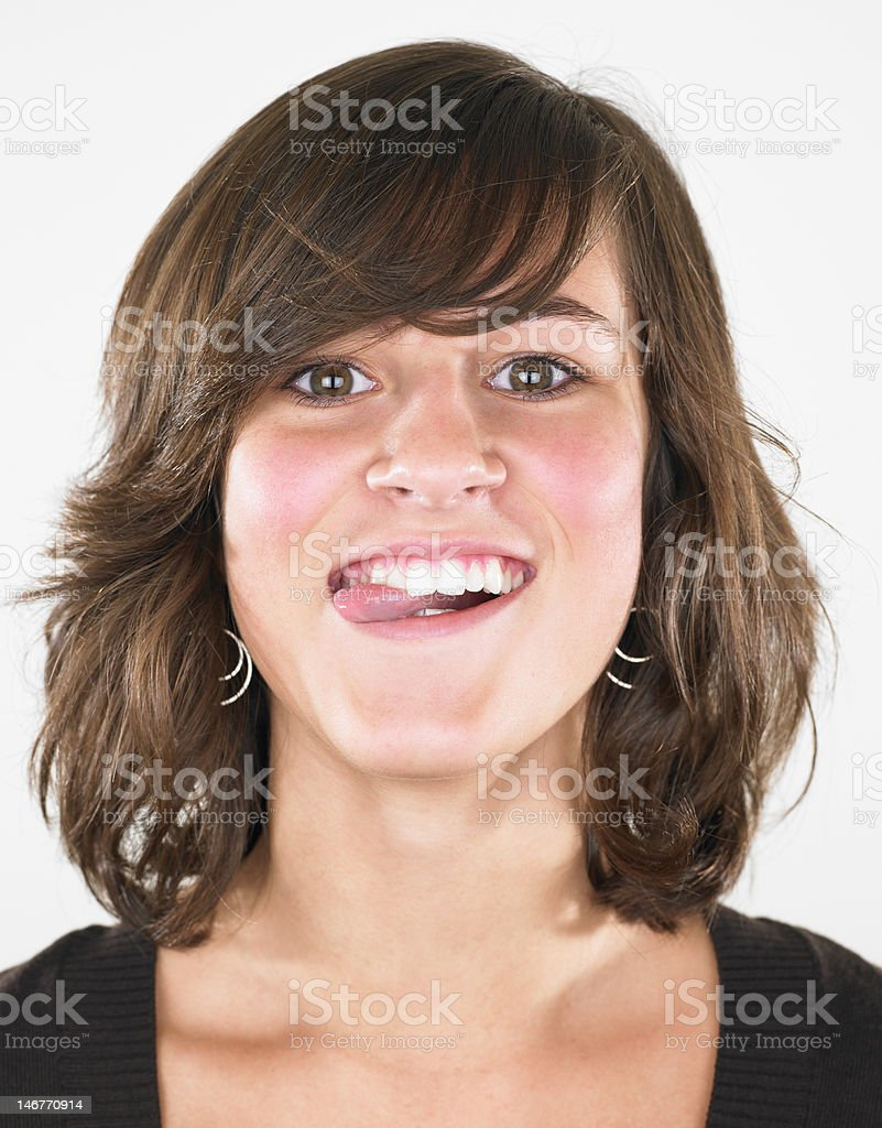 Teenage Girl Sticking Tongue Out royalty-free stock photo