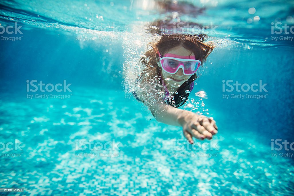 Teenage girl swimming crawl stock photo